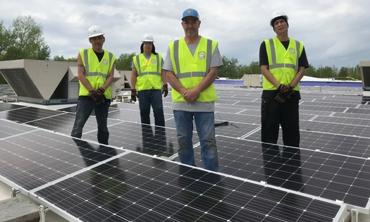 The Solar Bear crew, comprised of tribal members from the Red Lake Nation, works to install 200 kilowatts of solar power on the Oshkimiijiitahdah building. (Photo courtesy of Robert Blake)