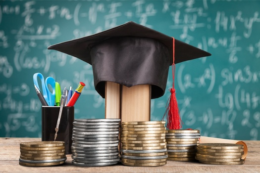 The average student debt load of a Michigan graduate is a little more than $30,000. (Adobe Stock)