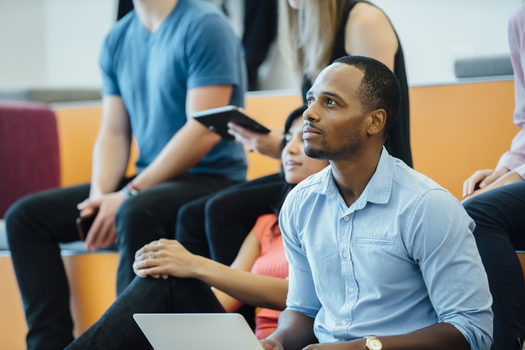 A new program aims to increase the number of adults of color attending community colleges by 2% nationally over the next two years. (Adobe Stock)<br />