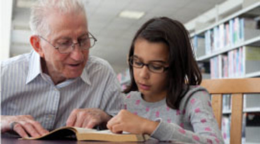 PHOTO: Grandfather reading to child