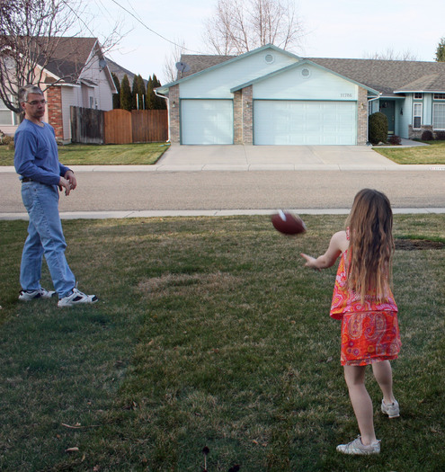 PHOTO: Father playing football with daughter. Photo Credit: Deborah Smith