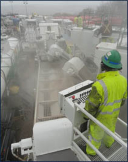 PHOTO: Silica dust by worker conducting sand transfer operations. Photo credit: NIOSH