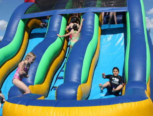 PHOTO: Kids on a water slide. Photo Credit: Deborah Smith