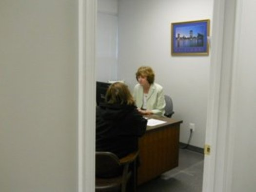PHOTO: Maryland Legal Aid paralegal meeting with a Pro Bono Day visitor