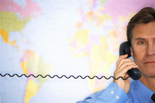 PHOTO: Man with map and telephone.