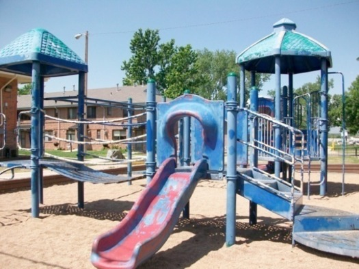 PHOTO: Mariposa Neighborhood (South Lincoln), park with graffiti on slides, 2009, Denver Housing Authority.
