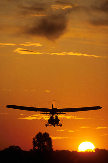 PHOTO: Crop duster at sunset