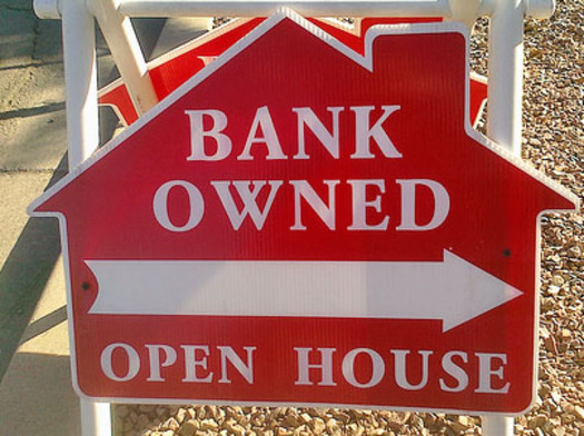 "PHOTO: ""Bank owned"" for sale sign. Photo credit: Deborah Smith"