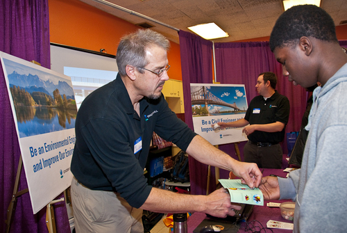 PHOTO: Fostering a diverse and inclusive engineering workforce is a top priority for CH2M HILL and employees frequently represent the firm at high school and college career fairs like this one in Milwaukee.