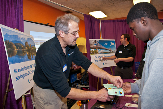 PHOTO: CH2M Hill is one company on the Equality Forum list, for its efforts to foster a diverse and inclusive engineering workforce. Here, employees represent the firm at a high school and college career fair. Courtesy of CH2M Hill.