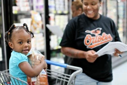 PHOTO: Mother shopping with child. Courtesy of Share Our Strength