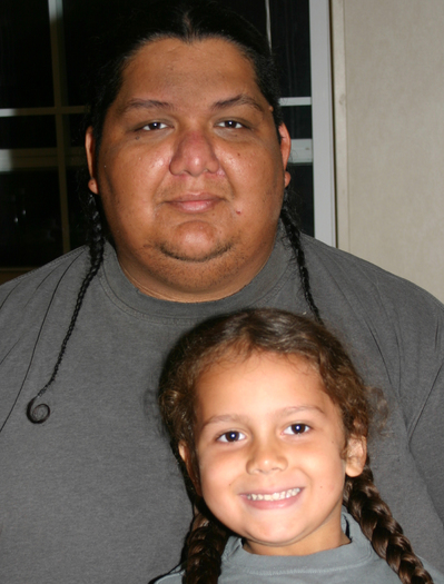 Kenney Arocha and his son, Adriel, who successfully argued in 2009 for a religious exemption from the Needville school district dress code because Adriel's braids were an expression of his Native American faith. Courtesy ACLU of Texas.