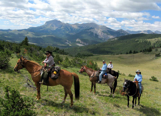 PHOTO: Horseback riding along the Rocky Mountain Front. Courtesy of Headwaters Economics.