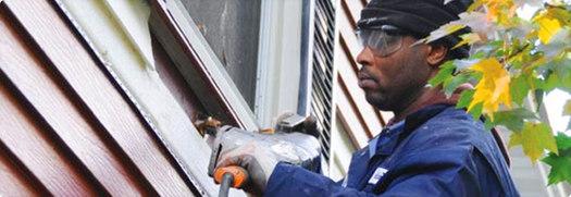PHOTO: Weatherization worker. Courtesy of Ohio Partners for Affordable Energy.