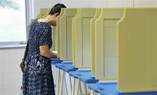 PHOTO: Voting booth. CREDIT: Courtesy 'Our Vote Our Future.'