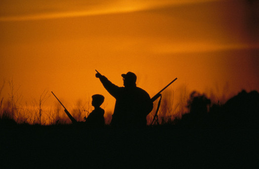 PHOTO: Man and youth hunting at sunrise. Photo credit: USFWS