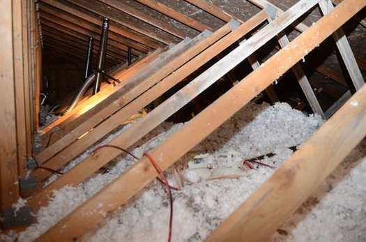 PHOTO: Image of cellulose blown in an attic to help reduce a homeowner's heating costs. CREDIT: Courtesy Minnesota Community Action Partnership.