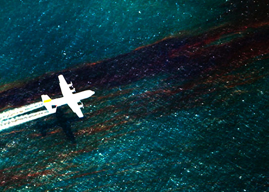 PHOTO: Plane spraying dispersants on spilled oil. Photo courtesy of the National Commission on the Deepwater Horizon Oil Spill and Offshore Drilling.