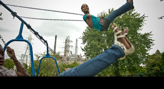 PHOTO: A Child in Belinger Park, located between the River Rouge plant and steel mill. Credit: Ami Vitale/Panos Pictures