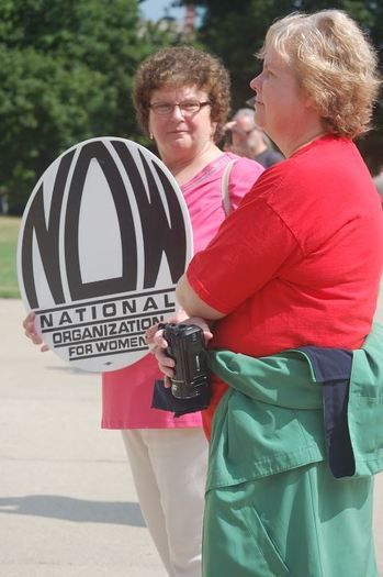 PHOTO: Mary Pollock at a State Capitol protest last summer. Courtesy of Michigan NOW.