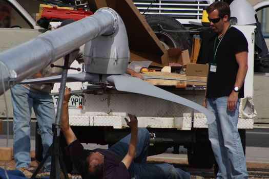 PHOTO: Students from Colorado School District 51 participate in the installation of a wind turbine at the district career center in Summer 2012. Courtesy Christy McGee.