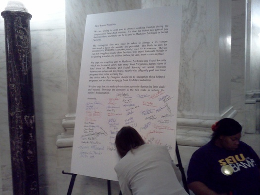The petition was delivered to WV Senator Joe Manchin's Charleston office on Monday afternoon. Photo by Dan Heyman.