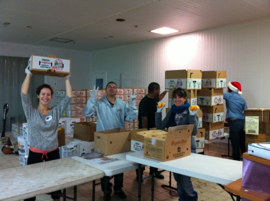 PHOTO: Members of the Community Alliance with Family Farmers prepare boxes of fresh food for local schools. Courtesy of CAFF.