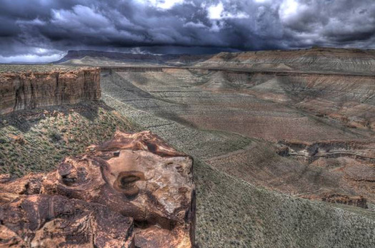 """PHOTO: Gas wells could be located on the far cliffs in this photo and in the """"bench"""" area beneath them under Gasco's Desolation Canyon project. Courtesy Southern Utah Wilderness Alliance."""