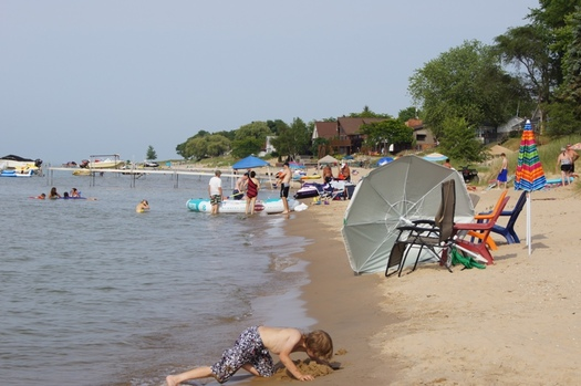 Millions of people flock to Michigan beaches in the summer. Recent cuts to environmental cleanup could threaten the quality of those beaches.