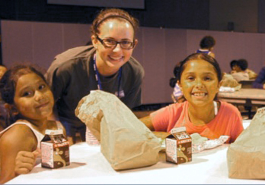 PHOTO: Federal sequestration is reducing the number of AmeriCorps VISTA members who help to feed hungry children meals during the summer months.  Photo courtesy of OAFB.