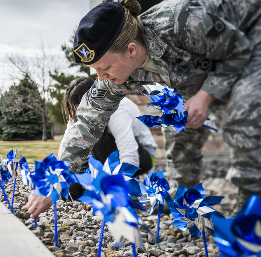 PHOTO: U.S. Air Force Staff Sgt. Sarah Hurtado, 366th Security Forces Squadron, plants pinwheels near the main gate at Mountain Home Air Force Base, Idaho, in recognition of Child Abuse Prevention Month. Photo credit: U.S. Air Force Tech. Sgt. Samuel Morse
