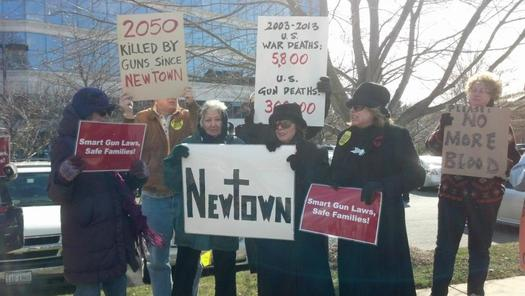 Photo: Momsrising celebrates new Maryland gun law.(Members shown here delivering petitions to the NRA) Photo credit: Momsrising