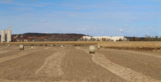 PHOTO: A giant mound of mined sand amidst Wisconsin farm fields. CREDIT: Carol Mitchell