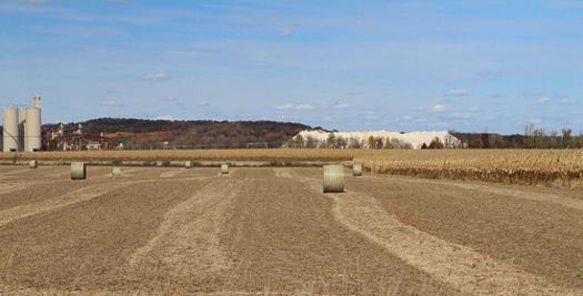 PHOTO: A giant mound of mined sand amidst Wisconsin farm fields. CREDIT: Carol Mitchell