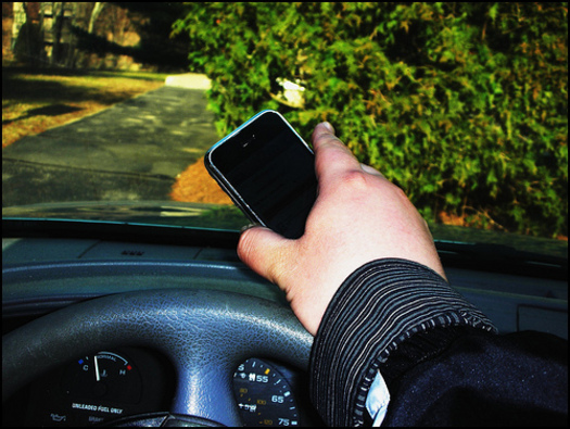 PHOTO: Drivers are being reminded of the dangers of distractions behind the wheel as the long holiday weekend continues. Texting is a major distraction, but officials say hands-free phones also take your attention away and can be just as dangerous. CREDIT: Robert Provost