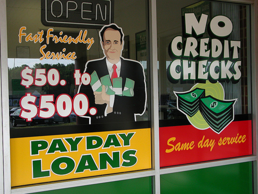 PHOTO: There is a push underway to change state law allowing the largest payday lenders charge higher rates and fees than others. Faith leaders say the costs take advantage of those who can least afford it. CREDIT: Taber Andrew Bain
