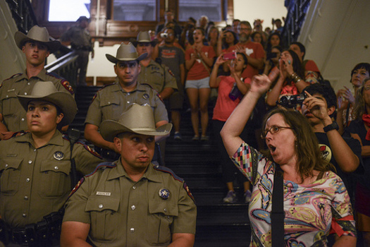 PHOTO: Texas Rangers lined the stairwells and halls of the Capitol rotunda during this month's peaceful protests against HB2. Photo by Lauren Gerson.