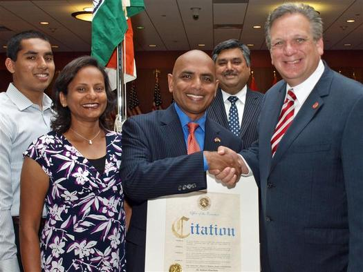 PHOTO: Among NY school superintendents waiting for an opportunity to apply for new Pre-K funding is Freeport's Dr. Kishore Kuncham (here being honored at 2012 Indian Independence Day celebration by Nassau County Executive Edward Mangano). Courtesy Freeport Public Schools.