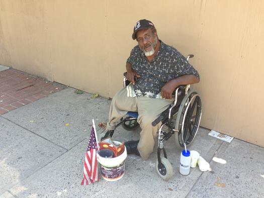 "Photo: ""Happy"" on the streets of Asheville. Courtesy: Joshua Martin"