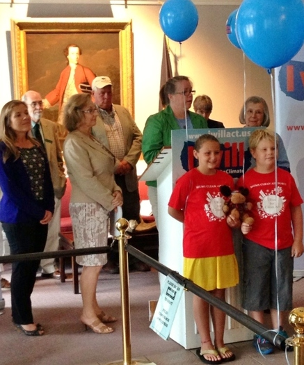 PHOTO: NH residents call for action on climate chance in Concord. Credit: Benton Strong