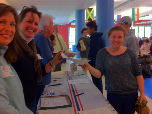 Photo of voter registration drive at Wilton High School. The League of Women voters is using the 93rd birthday of the 19th Amendment to highlight voter outreach. Photo Credit: Young-Kleinfeld