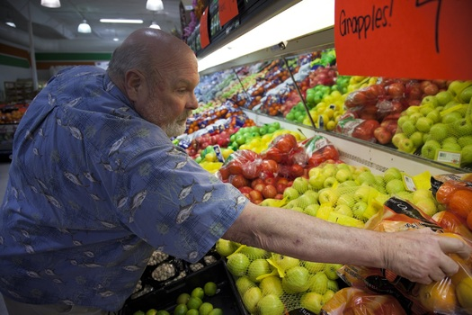 PHOTO: New data from the United States Department of Agriculture Economic Research Service indicates the continued prevalence of food insecurity in Ohio. PHOTO: Man purchasing produce. Credit: OAFB.