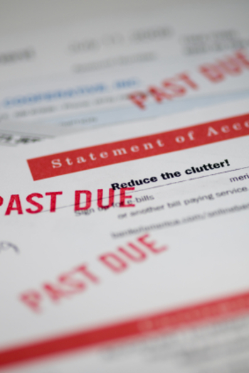 PHOTO: The National Consumer Law Center says many states, including Oregon, allow debt collectors to seize so much property and wages that it's harder for people in debt to regain their financial footing. Photo credit: iStockphoto.com.