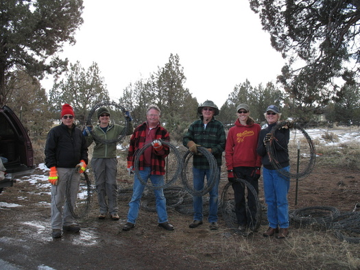 "PHOTO: Hauling away old barbed-wire fence materials is harder without the use of motorized vehicles, but the ""Fobbits"" – members of Friends of the Oregon Badlands Wilderness – are up to the challenge. Courtesy Friends of Oregon Badlands Wilderness."
