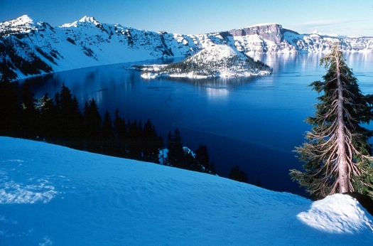 PHOTO: What a view � if you can get there. Crater Lake National Park access depends in part on keeping the roads open, and that depends on a sufficient budget. Photo credit: National Park Service.