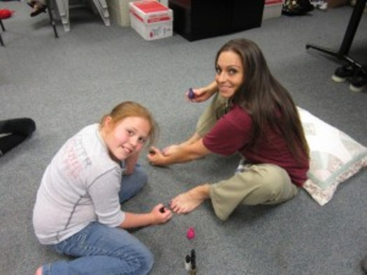 """PHOTO: """"Girl Scouts Beyond Bars"""" is able to arrange an occasional sleepover for daughters with moms who are incarcerated. Pedicures are just part of the fun. Photo courtesy Girl Scouts of Western Washington."""