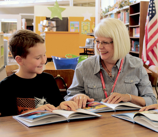 PHOTO: Peggy Armstrong, a longtime mentor in AARP's Experience Corps, works with a student at Hall Elementary in Gresham, one of 10 Portland area schools in the program. Photo courtesy Metropolitan Family Service.