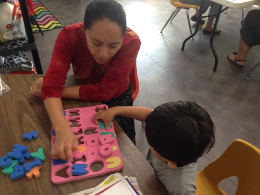 PHOTO: The YMCA Early Learning Readiness Program for Informal Family, Friend, and Neighbor Caregivers teaches those who watch young children how to provide better learning opportunities for those in their care. Photo courtesy YMCA of the USA.