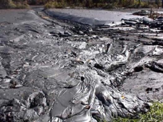 Photo: Coal ash sludge in Kingston, TN. Courtesy: cleanwateraction.org