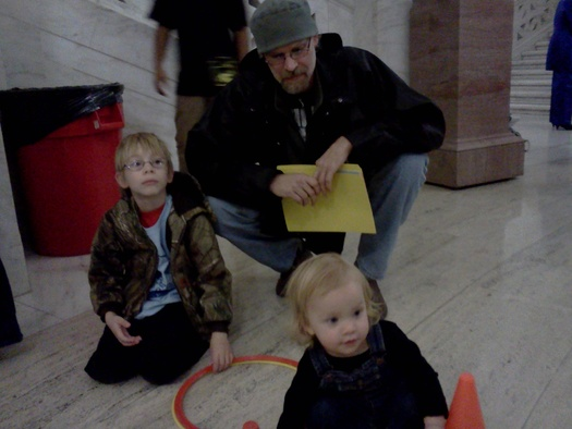 PHOTO: Cody Nicholas of Clay County brought his sons Jamie and Brian to the State Capitol for Kids and Families Day Tuesday, the same day as one of the bills backed by the day's organizers cleared a tough committee. PHOTO by Dan Heyman